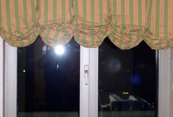 Custom-arched-shaped-pleated-window-treatments-drapery-balloon-shade