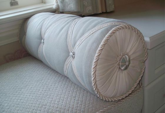 Custom-round-bolstered-cord-rosette-band-trimmed-pleated-ends-pillow