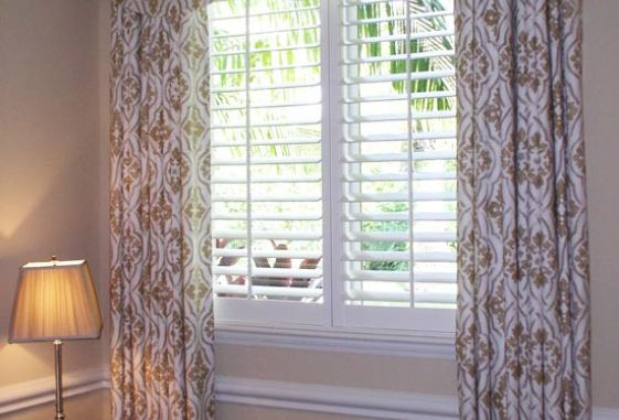 Custom-shaped-invert-pleated-valance-draw-drapery-plantation-shutters